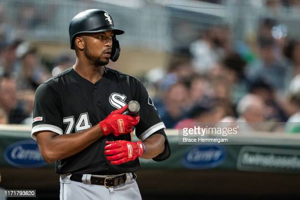 Eloy Jimenez of the Chicago White Sox looks on against the Minnesota Twins on August 19 2019 at the Target Field in Minneapolis Minnesota The White...