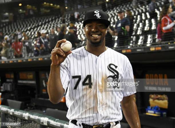 Eloy Jimenez of the Chicago White Sox poses with his first home run ball hit at home against the Washington Nationals during the fourth inning at...