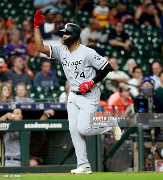 Eloy Jimenez of the Chicago White Sox reacts after hitting a home run in the eighth inning against the Houston Astros at Minute Maid Park on May 22...