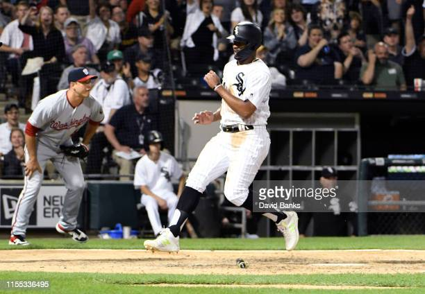 Eloy Jimenez of the Chicago White Sox scores against the Washington Nationals during the sixth inning at Guaranteed Rate Field on June 11 2019 in...