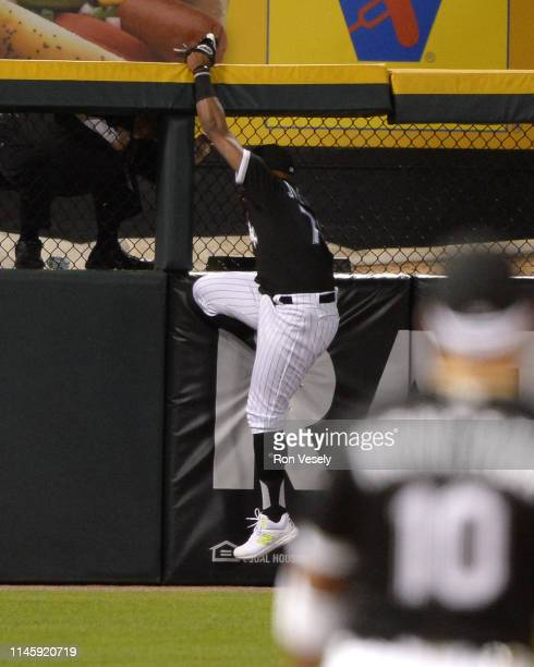 Eloy Jimenez of the Chicago White Sox suffers a high ankle strain while attempting to catch the baseball against the Detroit Tigers on April 26 2019...