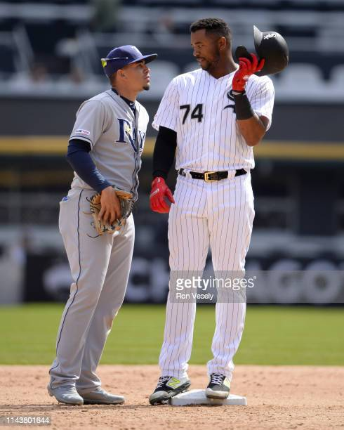Eloy Jimenez of the Chicago White Sox talks to Willy Adames of the Tampa Bay Rays on April 9 2019 at Guaranteed Rate Field in Chicago Illinois