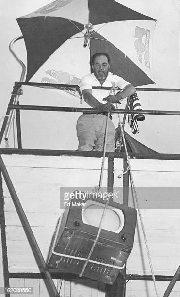 JUN 20 1955 JUN 24 1955 Eloy Maes a disabled war auto sales lot 300 Broadway since May 21 hauls to his perch a television set to help him spend his...