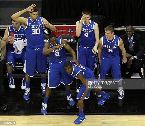 Eloy Vargas Stacey Poole Jr #2 Doron Lamb Jon Hood and Jarrod Polson of the Kentucky Wildcats celebrate from the bench after play against the Ohio...