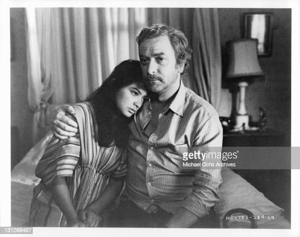Elpidia Carrillo is comforted by her husband Michael Caine in a scene from the film 'Beyond The Limit' 1983