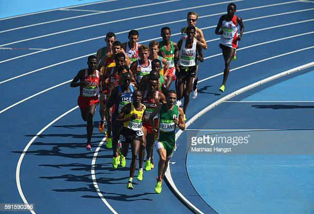 Elroy Gelant of South Africa and Phillip Kipyeko of Uganda leads the pack in the Men's 5000 metres round 1 on Day 12 of the Rio 2016 Olympic Games at...