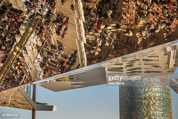 Els Encants market with mirror on the ceiling and people shopping in the stores with the Agbar tower on the background Catalonia Europe