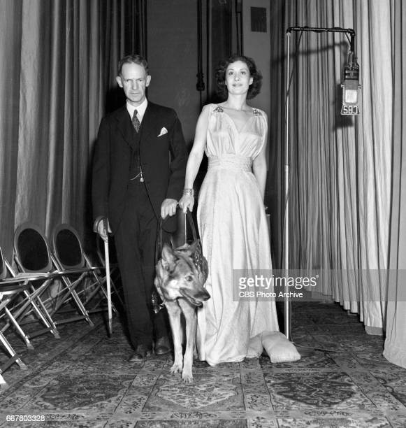 Elsa a seeing eye dog is shown here with actress Gloria Holden and Dr Clyde Wilson Dr Wilson who is blind acted as technical advisor on the CBS Radio...