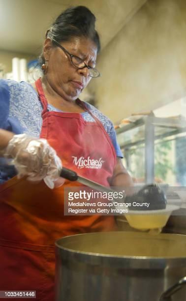 Elsa Alvarado stirs a pot of chicken soup before doors open for breakfast at the Southwest Community Center in Santa Ana She has worked there for 30...