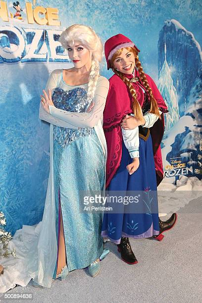 Elsa and Anna pose at Disney On Ice Presents Frozen Los Angeles Premiere at Staples Center on December 10 2015 in Los Angeles California