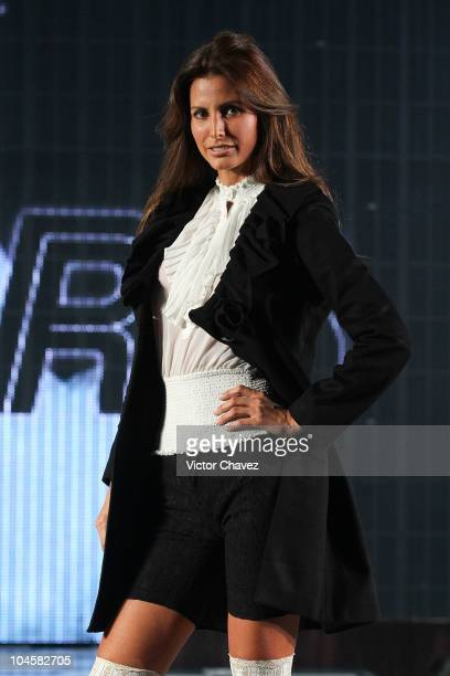 Elsa Benitez walks the runway during the Sears Fashion Parade Autumn Winter 2010 at Ragga Plaza Antara on September 29 2010 in Mexico City Mexico