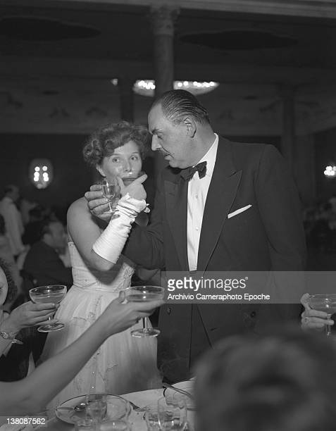 Elsa De Giorgi toasting with Raul Radice at the party for the 'Acqua Panna' prizegiving Venice 1950s