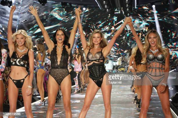 Elsa Hosk, Adriana Lima, Behati Prinsloo, and Candice Swanepoel pose during the finale of the 2018 Victoria's Secret Fashion Show at Pier 94 on...