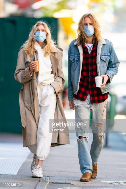 Elsa Hosk and Tom Daly are seen wearing protective face masks during the COVID19 pandemic in SoHo on April 22 2020 in New York City