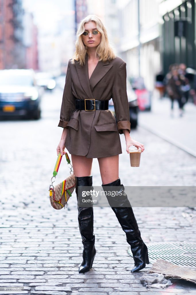 Elsa Hosk is seen wearing a Frankie jacket, Yves Saint Laurent boots and belt with a Dior handbag in SoHo on January 27, 2018 in New York City.