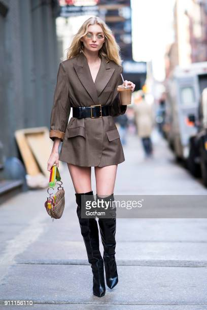 Elsa Hosk is seen wearing a Frankie jacket Yves Saint Laurent boots and belt with a Dior handbag in SoHo on January 27 2018 in New York City