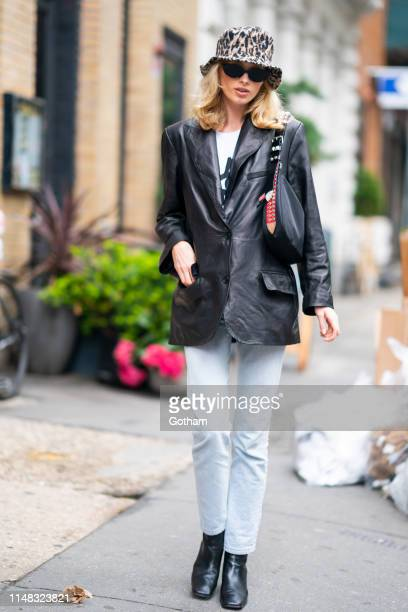 Elsa Hosk is seen wearing a J. Brand jacket with By FAR shoes and a Prada handbag in SoHo on May 10, 2019 in New York City.