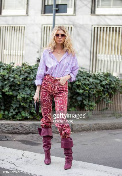 Elsa Hosk is seen wearing pink striped button shirt pants with print purple boots outside Etro during Milan Fashion Week Fall/Winter 20202021 on...