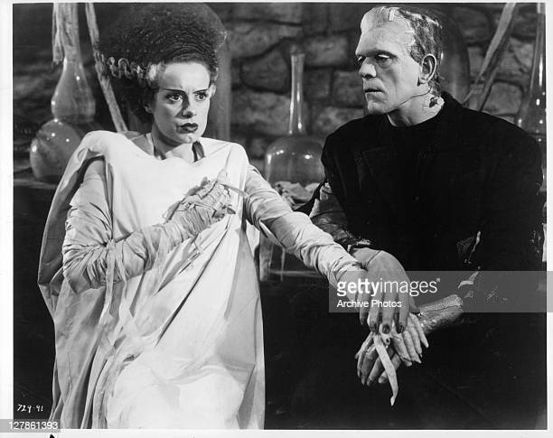 Elsa Lanchester holding hand of Boris Karloff in a scene from the film 'Bride Of Frankenstein' 1935