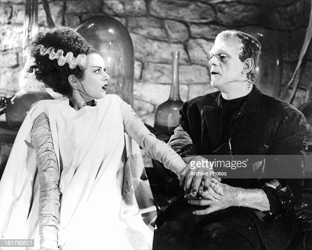 Elsa Lanchester reacts as Boris Karloff grabs her hand in a scene from the film 'Bride Of Frankenstein' 1935