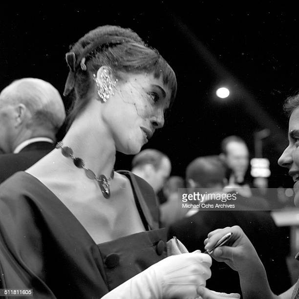 Elsa Martinelli attends a party as she signs an autograph in Los AngelesCA