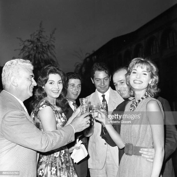Elsa Martinelli Gino Cervi Rosanna Schiaffino Sandro Jacovoni Mauro Bolognini make a toast in Rome in 1959