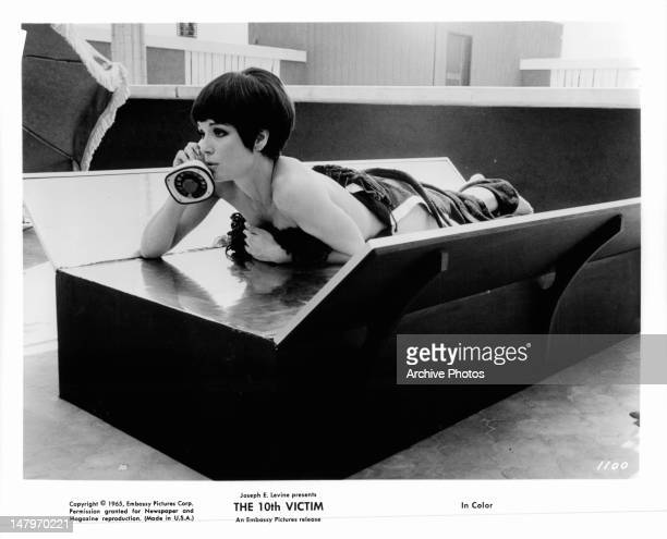 Elsa Martinelli laying on table wearing only a towel in a scene from the film 'The 10th Victim', 1965.