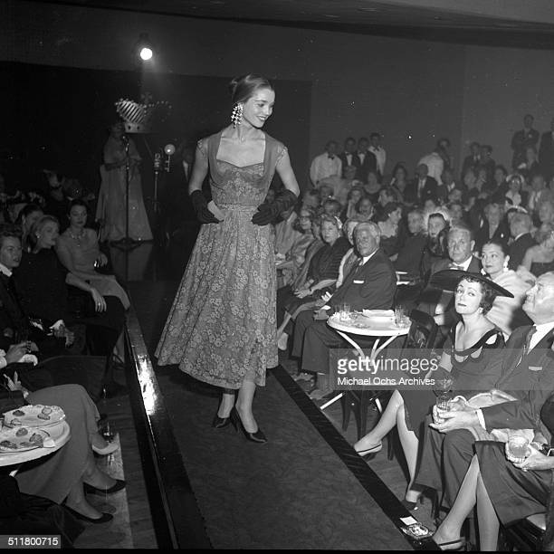 Elsa Martinelli walks down the runway during the Romanoff's restaurant fashion show in Los AngelesCA
