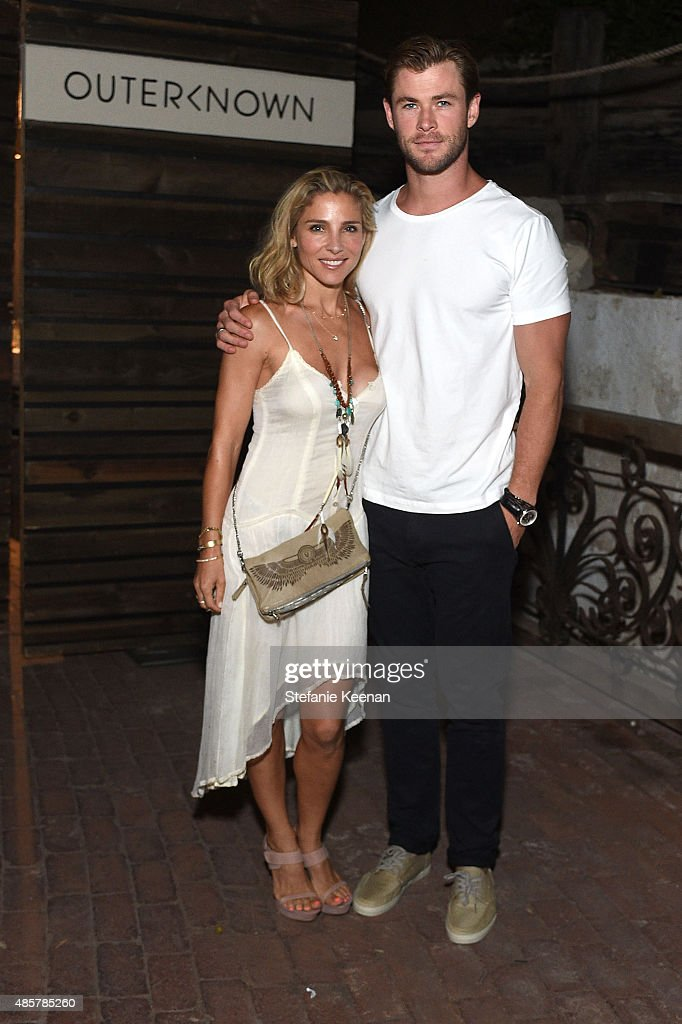 Elsa Pataky and Chris Hemsworth attend Kelly Slater, John Moore and Friends Celebrate the Launch of Outerknown at Private Residence on August 29, 2015 in Malibu, California.