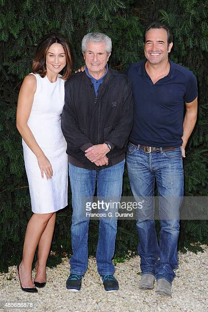 Elsa Zylberstein Claude Lelouch and Jean Dujardin attend a photocall for the film 'Un Une' during the 8th Angouleme FrenchSpeaking Film Festival on...