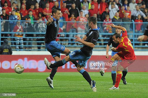 Elsad Zverotic of Montenegro beats John Terry and Gary Cahill of England to score his team's first during the UEFA EURO 2012 Group G qualifier match...