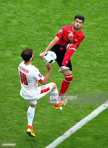 Elseid Hysaj of Albania and Admir Mehmedi of Switzerland compete for the ball during the UEFA EURO 2016 Group A match between Albania and Switzerland...