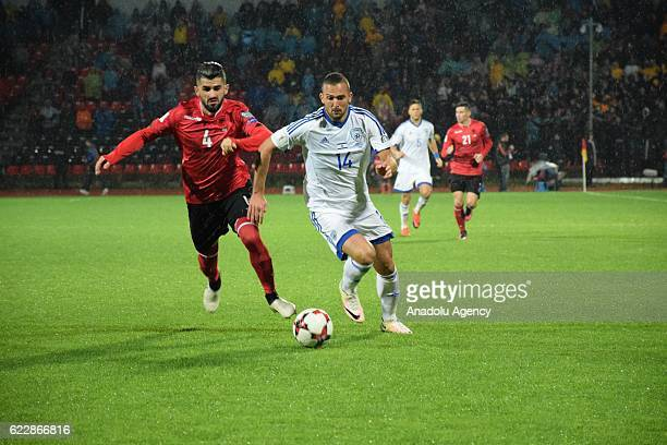Elseid Hysaj of Albania vies witj Ben Sahar during the World Cup 2018 qualifier football match between Albania and Israel at the Elbasan Arena...
