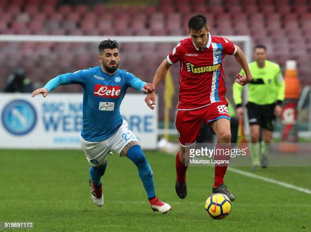 Elseid Hysaj of Napoli competes for the ball with Alberto Grassi of Spal during the serie A match between SSC Napoli and Spal at Stadio San Paolo on...