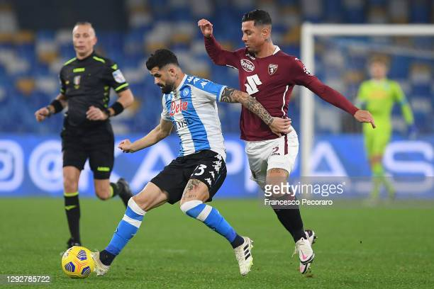 Elseid Hysaj of SSC Napoli is challenged by Armando Izzo of Torino during the Serie A match between SSC Napoli and Torino FC at Stadio Diego Armando...