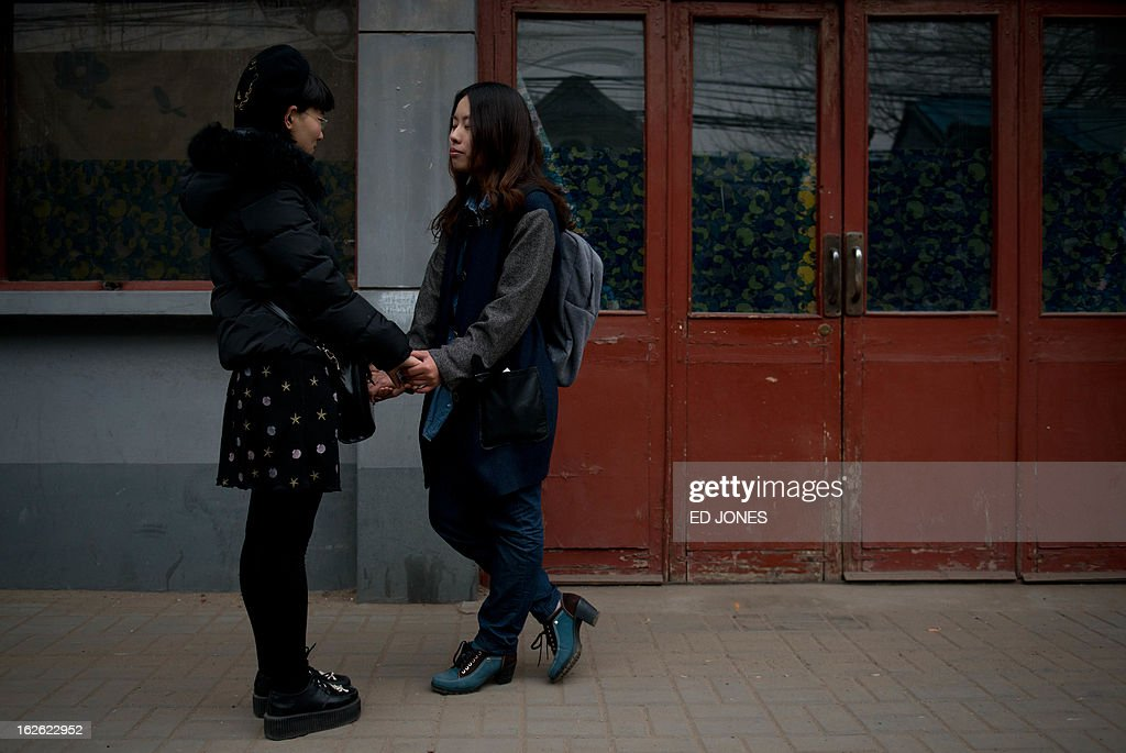 Elsie Liao (R) and Mayu Yu stand in an alleyway outside the registry office where they asked to be married, before being turned away, in Beijing on February 25, 2013. Although not in a relationship together, the pair sought to draw attention to China's stance on same-sex marriage which is not recognised by law, the lack of access to social benefits available to couples, and to promote public awareness of discrimination against the LGBT community. China's government has an un-verified but widely reported 'three no's' policy towards homosexuality; no approval, no disapproval, no promotion. Same-sex acts were decriminalised in China in 1997, and homosexuality was removed from the country's mental illness list in 2001. As of June 2012 a 14-year-old ban was lifted allowing lesbians, although not gay men, to give blood. AFP PHOTO / Ed Jones
