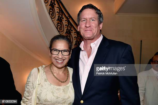 Elsie McCabe Thompson and John Regan attend Katrina and Don Peebles Host NY Mission Society Summer Cocktails at Private Residence on July 7 2017 in...