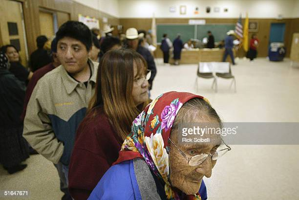 TO'HAJIILEE NM NOVEMBER 2 Elsie Werito a member of the To'hajiilee Chapter of the Navajo Nation waits in line to cast her ballot at the Desiderio...