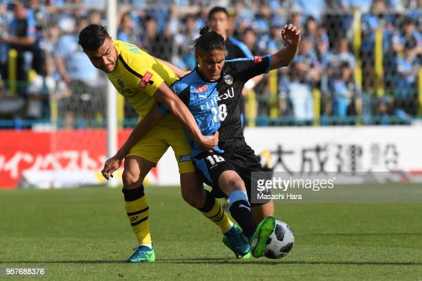 Elsinho of Kawasaki Frontale and Cristiano of Kashiwa Reysol compete for the ball during the JLeague J1 match between Kashiwa Reysol and Kawasaki...