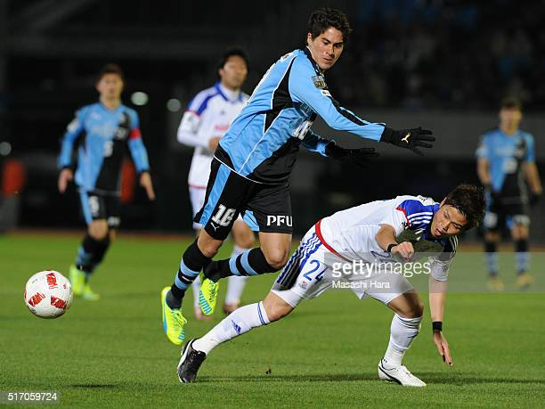Elsinho of Kawasaki Frontale and Takashi Kanai of Yokohama F.marinos compete for the ball during the J.League Yamazaki Nabisco Cup match between...