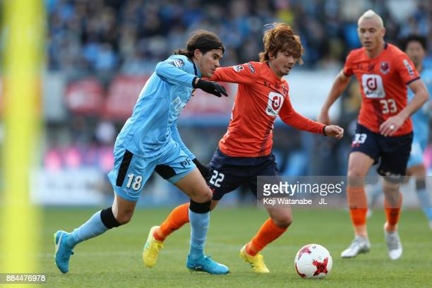 Elsinho of Kawasaki Frontale and Takuya Wada of Omiya Ardija compete for the ball during the JLeague J1 match between Kawasaki Frontale and Omiya...