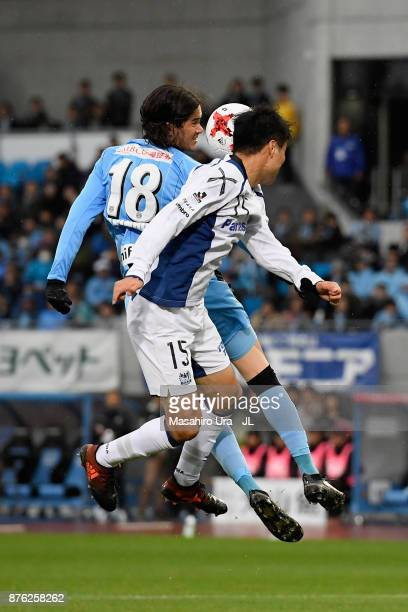 Elsinho of Kawasaki Frontale and Yasuyuki Konno of Gamba Osaka compete for the ball during the JLeague J1 match between Kawasaki Frontale and Gamba...