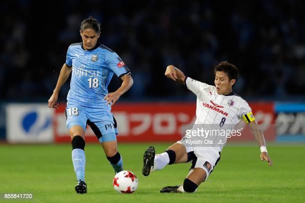 Elsinho of Kawasaki Frontale and Yoichiro Kakitani of Cerezo Osaka compete for the ball during the JLeague J1 match between Kawasaki Frontale and...
