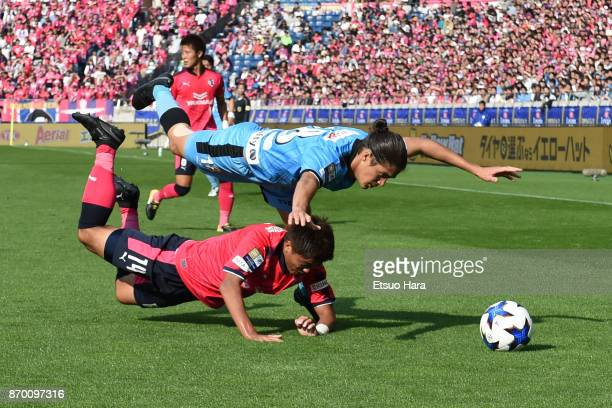 Elsinho of Kawasaki Frontale and Yusuke Maruhashi of Cerezo Osaka compete for the ball during the JLeague Levain Cup final match between Cerezo Osaka...