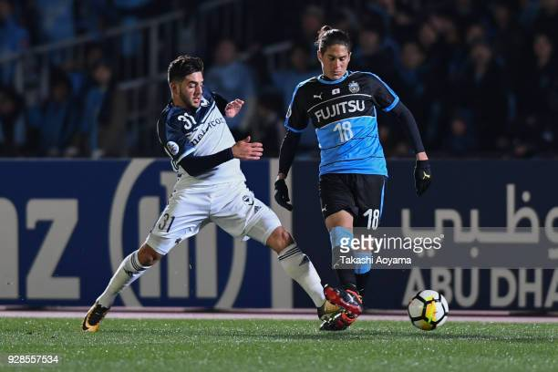 Elsinho of Kawasaki Frontale compete for the ball against Christian Theoharous of Melbourne Victory during the AFC Champions League Group F match...