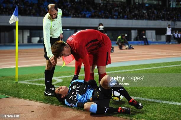 Elsinho of Kawasaki Frontale lies injured during the AFC Champions League Group F match between Kawasaki Frontale and Shanghai SIPG at Todoroki...
