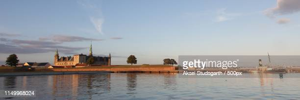 elsinore castle reflected in the water - helsingor stock pictures, royalty-free photos & images