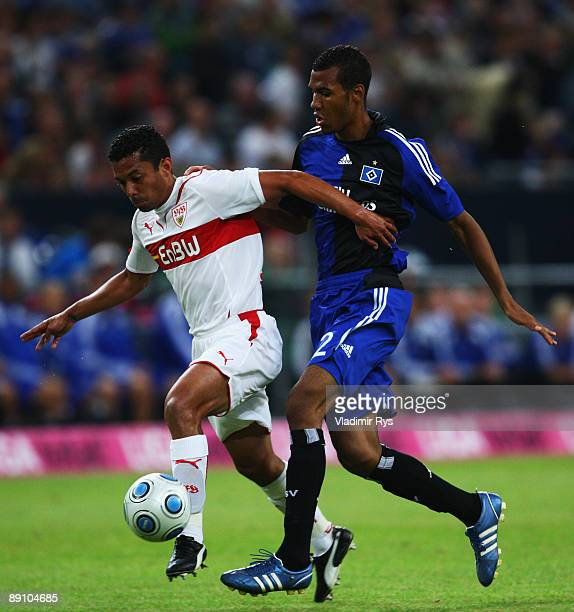 Elson Falcao da Silva of Stuttgart and EricMaxim Choupo Moting of Hamburg battle for the ball during the THome Cup final match between VfB Stuttgart...