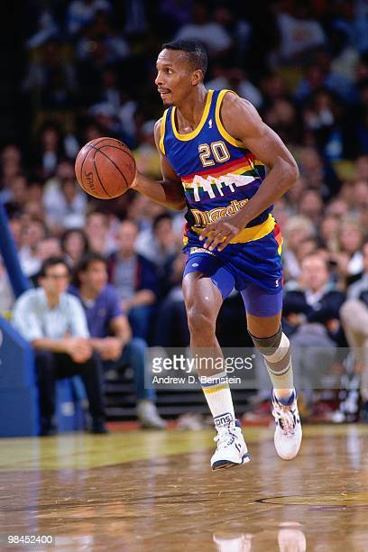 Elston Turner of the Denver Nuggets dribbles during an NBA game against the Los Angeles Clippers played in 1989 at the Los Angeles Sports Arena in...