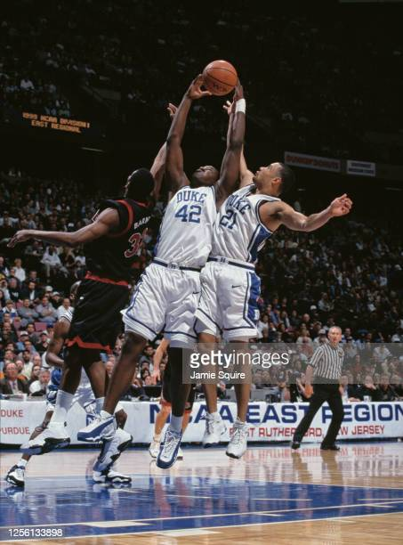 Elton Brand and team mate Trajan Langdon for the Duke University Blue Devils contest the rebound ball with Lamont Barnes of the Temple University...